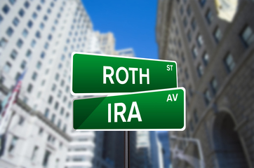 Small roth ira street sign on wall street
